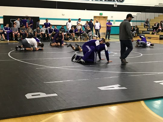 Coach Joe Imelli guides Spanish Springs before a dual meet at North Valleys on Dec. 13.