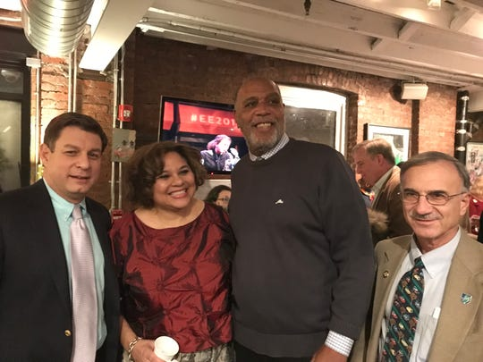 Melissa Walker, second from left, stands with Montclair Township Councilmember Bill Hurlock, far left; Mayor Robert Jackson, second from right; and Councilmember Robert Russo at the Jazz House Kids Holiday Open House and Jam Session.