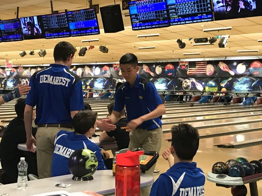 After bowling a strike, Jordan Tse is congratulated by NV/Demarest teammate Nick Allegro during a match versus Tenafly at Bowler City on Dec. 21, 2017. The Norsemen sit atop the Big North National standings entering the season's holiday break.