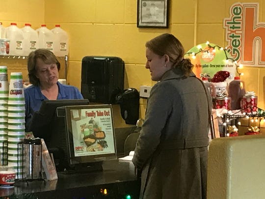 Nancy Langkamer, general manager of Petro's Chili & Chips Cafe, takes customer Melanie Daniel's order on Dec. 21 at the Cedar Bluff Road location.