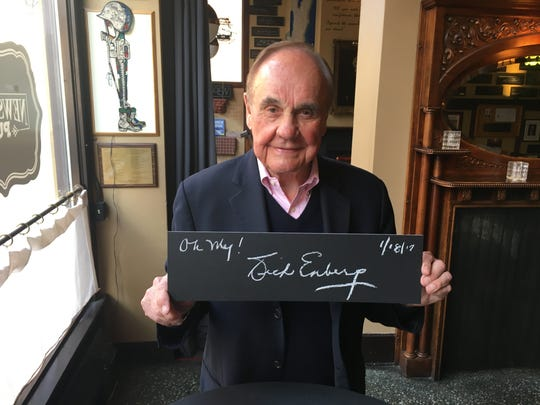 "On a visit to Milwaukee in connection with his play ""McGuire,"" Dick Enberg signed a plaque at the Milwaukee Press Club."
