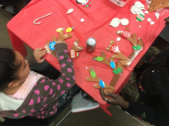 Residents decorate crafts at the Delaware Valley Development Co.'s Christmas event.