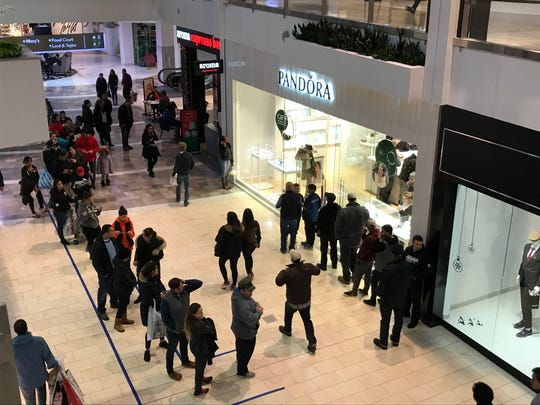Shoppers line up outside of Pandora in the Garden State Plaza on Saturday, the last shopping day before Christmas at Bergen County malls.
