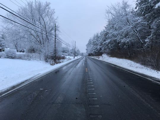 Snow falls on State Route 32 North in New Paltz on Christmas morning Monday.