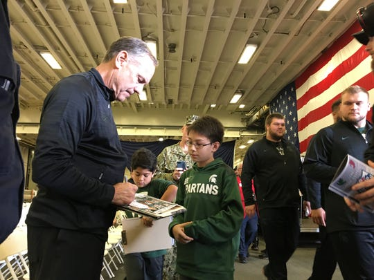 MSU coach Mark Dantonio signs autographs for Brennan