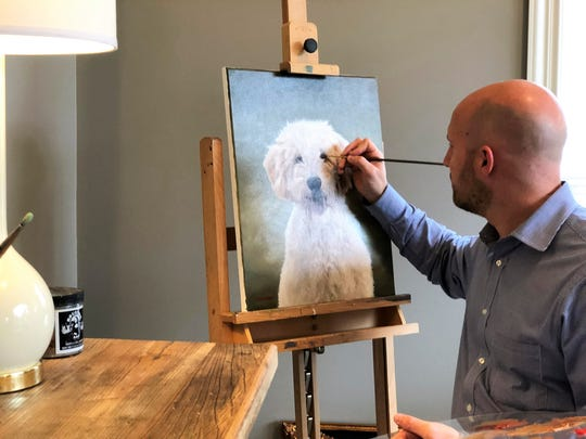 Danny Simmers puts the finishing touches to a portrait of Piper.