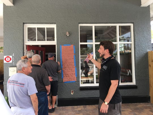 Customers wait in line for Cryderman's Barbecue, which opened this year in Cocoa Village.