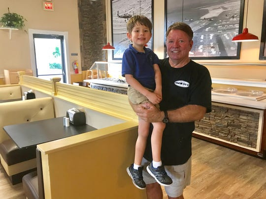 Mark Hendry, owner of City Subs in Cape Coral, with his 5-year-old son Ian.