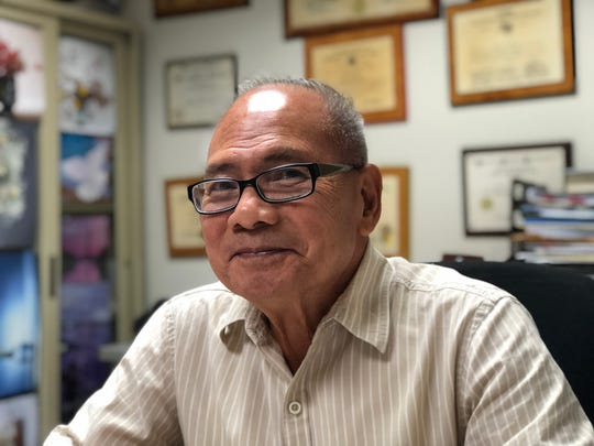 Dr. Aurelio Espinola, Guam's chief medical examiner for the past 23 years, sits at his desk in his office in Tamuning on Dec. 28, 2017. Espinola will retire in January 2019, giving the government about a year to hire his replacement.