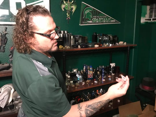 Former Michigan State running back Blake Ezor shows off his rare rock collection inside his home office in Las Vegas.