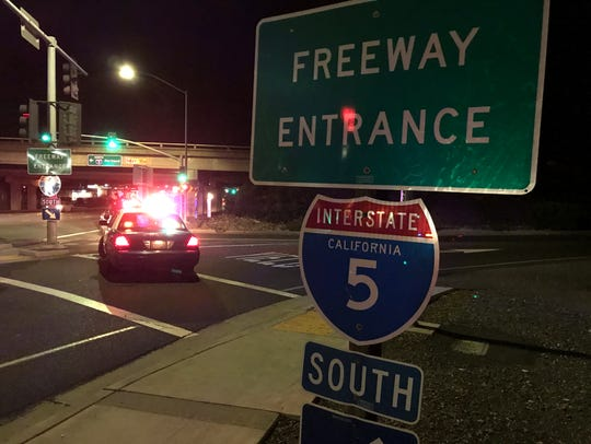 Two Redding patrol cars block the southbound on-ramp