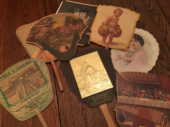 Piland has a collection of hand fans, which carried advertising for Springfield businesses. The photo on the fan often had little connection with the business.