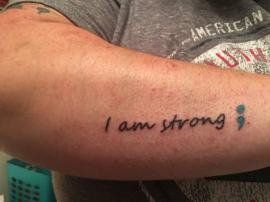 Laura Peters's new tattoo, with the semicolon symbol, which is used to symbolize suicide awareness and prevention.
