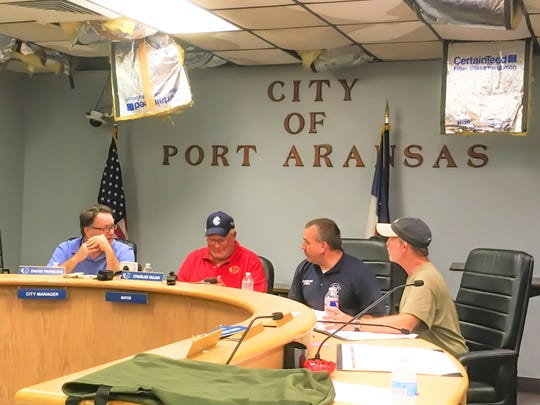 Port Aransas Mayor Charles Bujan, second from left, holds a meeting in the Port Aransas City Council Chambers with other officials on Aug. 31. The room shows signs of the damage the building sustained from Hurricane Harvey on Aug. 25.
