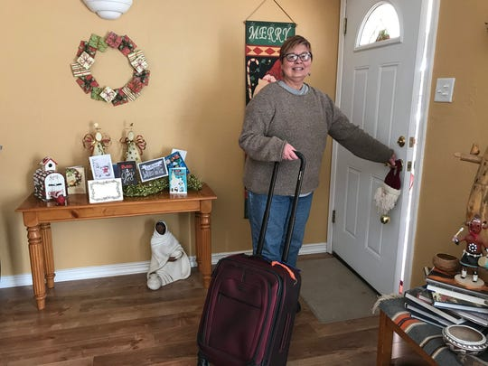 Karen Garcia has big plans for the New Year: traveling to Hawaii for 15 days with a good friend in March. Some believe you have to run around with a suitcase on New Year's Eve to ensure some traveling in the new year.