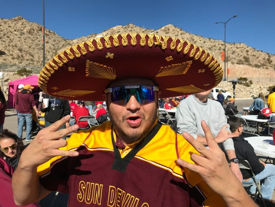 Nick James of Phoenix shows his colors at a fan pregame