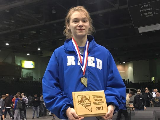 Reed's Morgan Norris won a title at the Sierra Nevada Classic wresting tournament on Friday.
