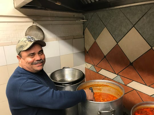 Hector Chavez, owner of Jalisco Cafe, is preparing