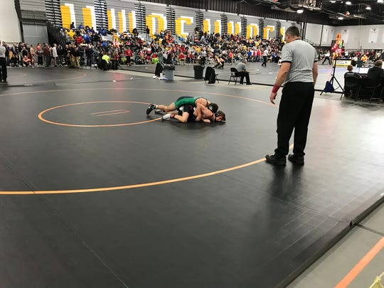 Coleman's Jake Baldwin works for control of Lomira's Noah Danner in a 138-pound quarterfinal match at the On The Water Classic on Friday.