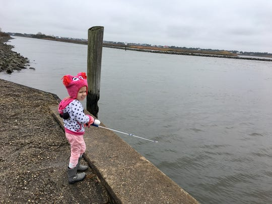 Avery Guidry, 3, learns to fish on a very cold and