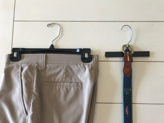 When faced with a ridiculously small space in his closet, an overabundance of belts and a pile of unused dry cleaner pant hangers; Stan Wallace of Naples came up with the perfect solution. He saws the clips off both sides of the hangers and hangs a few belts on each hanger. The real beauty of this system is that he has utilized an otherwise impractical space.