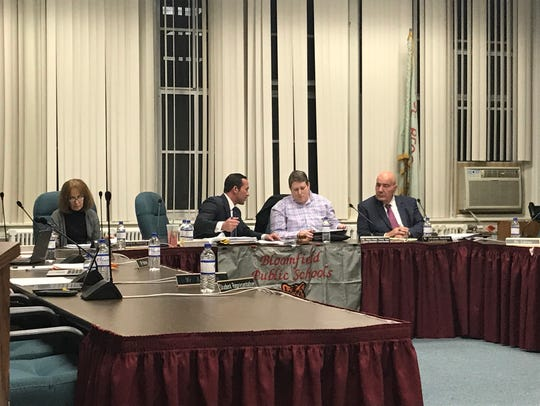 Jill Fischman, second from left, consults with Bloomfield school board attorney Nicholas Dotoli at the board's Tuesday, Dec. 2, reorganization meeting as Schools Superintendent Salvatore Goncalves looks on from right.