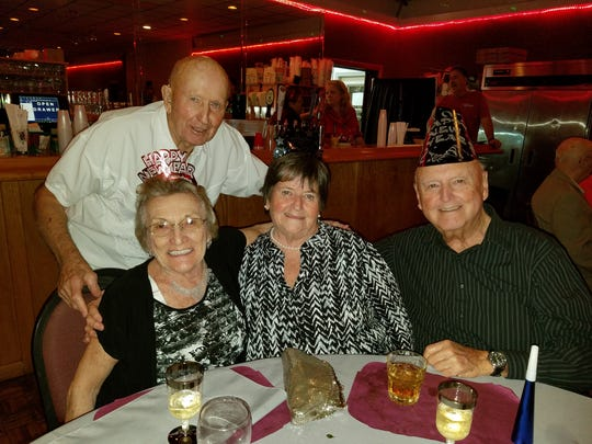 Jim and Ruth Lambert, left, with Sandy and Ken Carrier at the Fort Pierce Elks Lodge on New Year's Eve.