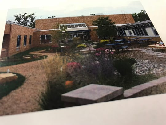 An image of what the future plans could look like at the courtyard at Mead Elementary Charter School on an OLC flyer