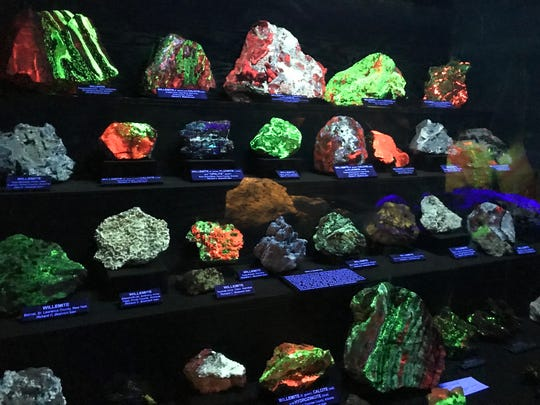 The most famous rocks at the Sterling Hill Mining Museum are the ones that fluoresce. A case containing a variety of the stones, many of which are found in the area, is illuminated on Oct. 17, 2017.