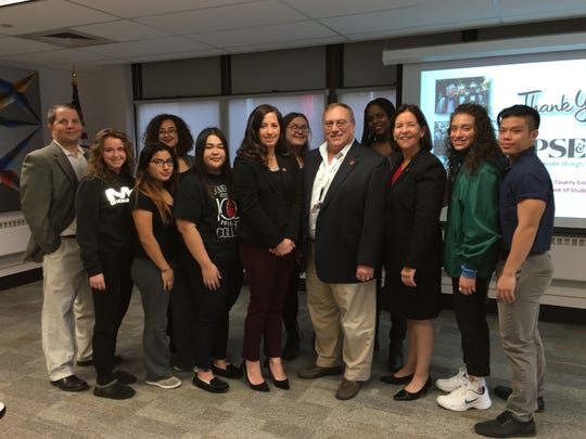 At left, Union County College Foundation Executive Director Doug Rouse, PSEG's Maria Spina and Jeffrey Katz (center), Union's President Margaret M. McMenamin (third from right) surrounded by Union students.