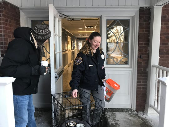 Parsippany Animal Control Officer Heidi Mooney removes