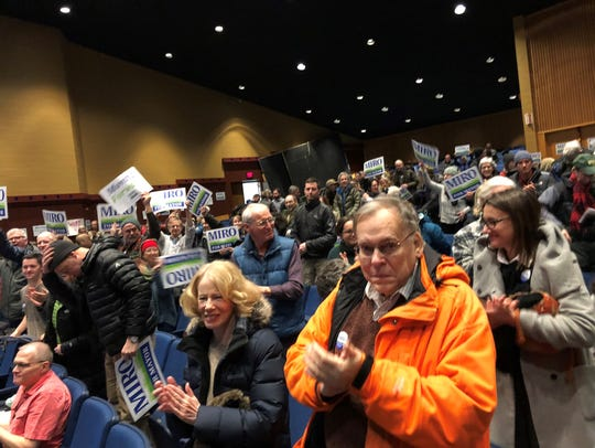 Caucusgoers applaud at the Democratic caucus on Jan