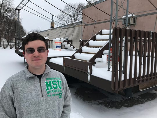 Sam Fitzgerald with the DeWitt stage used for the annual summer Ox Roast as it looked in January 2018. Fitzgerald enclosed the stage for his Eagle Scout Project.