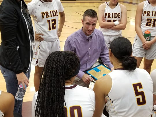 Mountain Pointe head coach Justin Hager addresses his team during a timeout against Highland on Dec. 5, 2017.