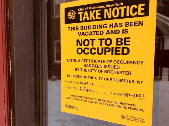 A condemnation notice on the door at 960 Dewey Avenue.