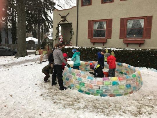 Neighborhood children help the Riedy family build an