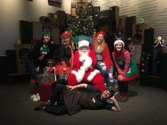 Big Grove Iowa City employees pose with Santa Claus