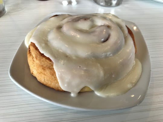 The cinnamon roll ($4.25) at Meridian Cafe is large
