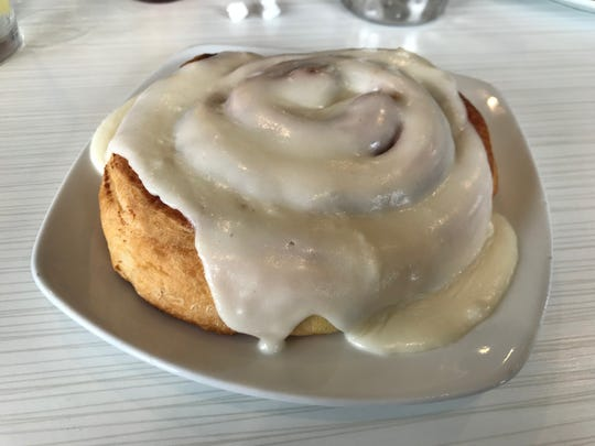 The cinnamon roll ($4.25) at Meridian Cafe is large enough to satisfy the sweet tooth (teeth?) of many at your table.