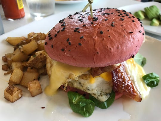 The breakfast sandwich ($10.75) includes a fried egg
