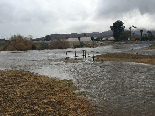 Water flows across Cathedral Canyon Drive at the Whitewater Wash in Cathedral City.