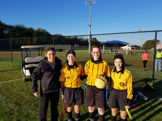 Stewarts Creek soccer coach Brooke Mayo (left) is shown with (l-r) Malayna Allen, Grayson Stem and Sara McKee, three younger referees to whom she mentors. Mayo was recently named a FIFA assistant referee.