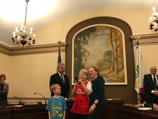 Glen Ridge Borough Councilwoman Deborah Mans stands with her oldest son taking a selfie after she was sworn in to the council on Monday for her first three-year term.