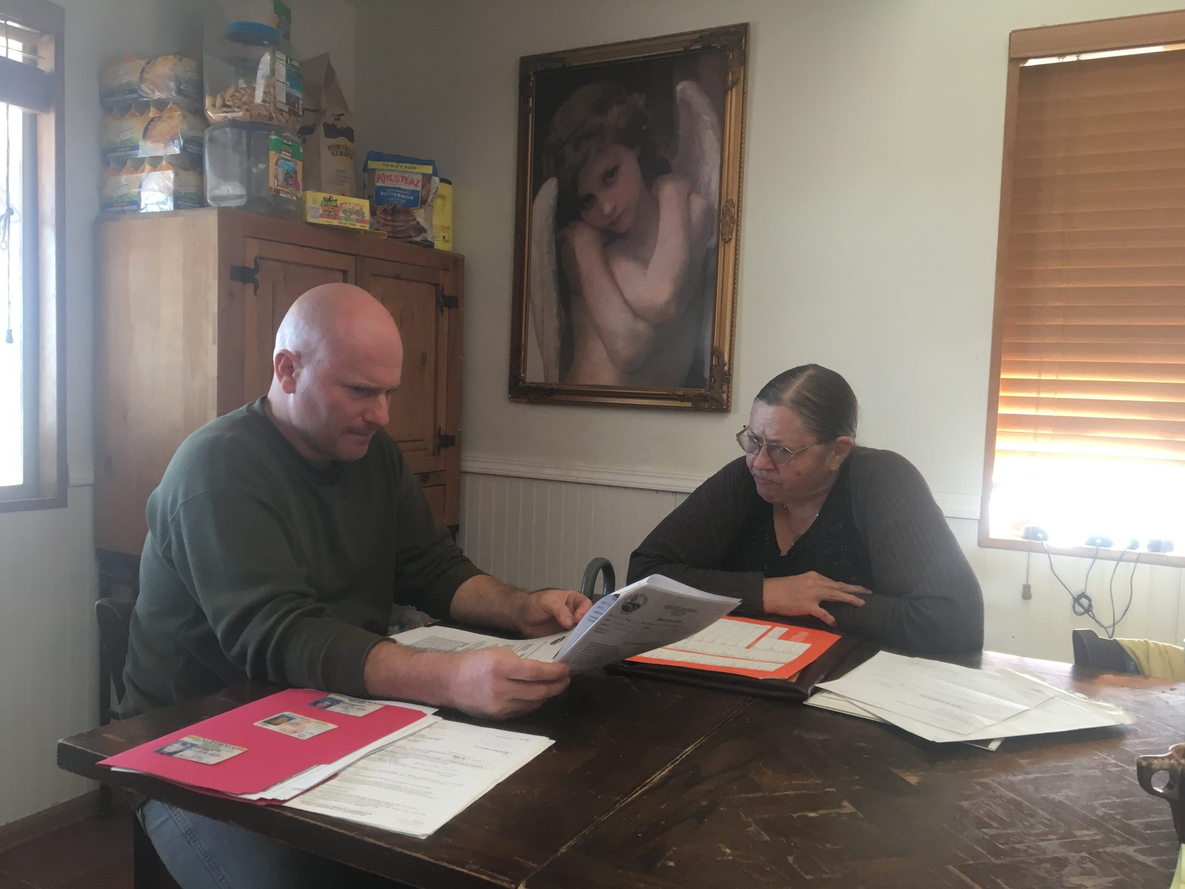 Christopher Slade and Suzanne Avila, the grandson and daughter of Marjorie Sansom, review citations and legal documents that Coachella mailed to an old address where Sansom did not live. The city says that, because Sansom did not respond to these citations, Slade and Avila are responsible for her debt.