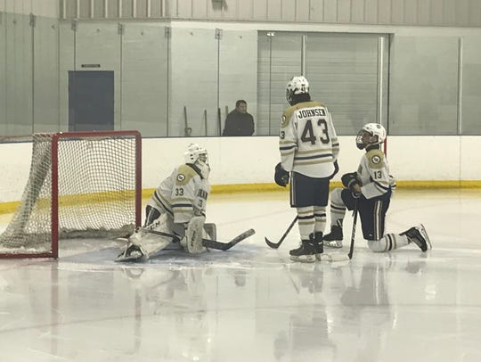 Indian Hills goaltender Joe Bagi (33) warms up for