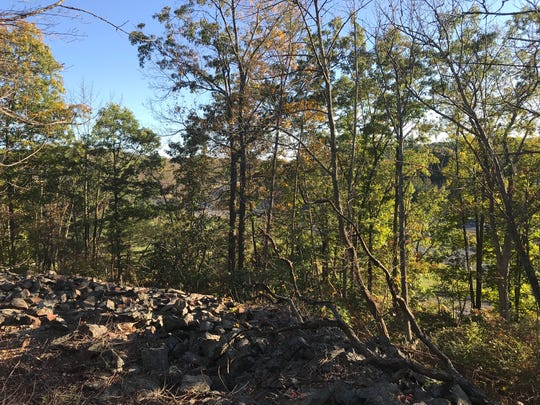 The Hurd Mine in Jefferson Township, N.J., seen on Oct. 17, 2017, sits next to a highway covered in rock and hidden by trees.