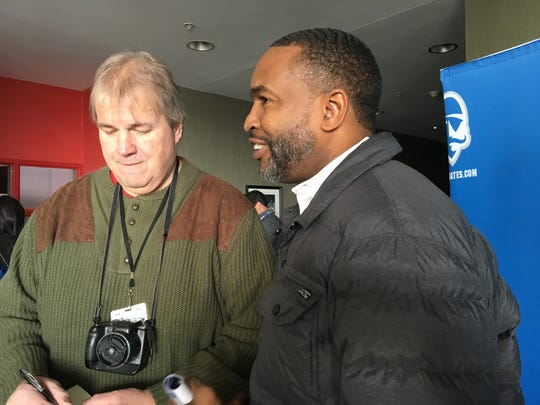 Seton Hall great Terry Dehere (right) speaks with reporters during the pre-game reunion of the 1992-93 Pirates squad in 2018