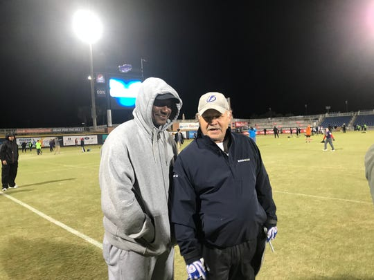 Derrick Brooks and Dave Wilson, who is director of Pensacola Friday Night Lights Flag Football program, were part of those braving frigid weather Friday at Blue Wahoos Stadium for the weekly games.