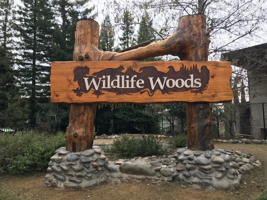 Miki'ala Catalfano of Turtle Bay Exploration Park designed the Wildlife Woods entrance sign depicting animal silhouettes.