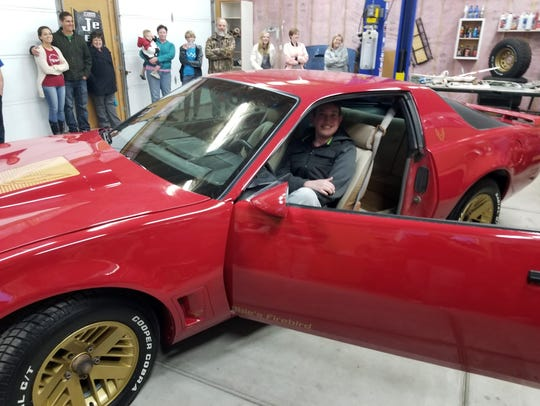 Obie Nef sits in his new 1987 Pontiac Firebird.
